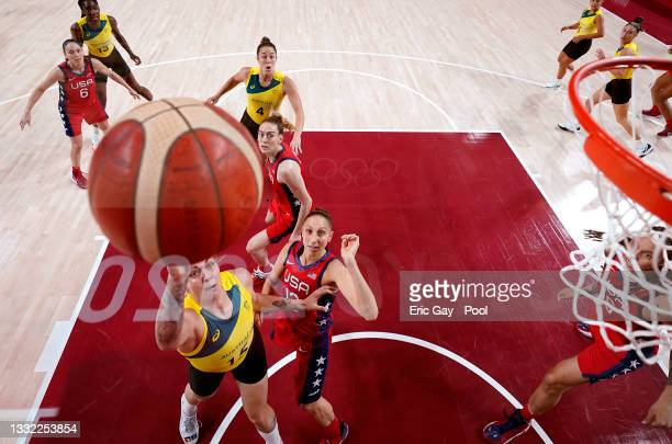 Cayla George of Team Australia goes up for a shot against Diana Taurasi of Team United States during the first half of a Women's Basketball...