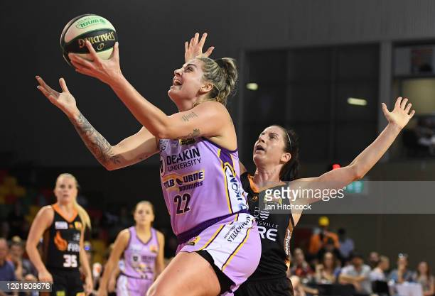 Cayla George of the Boomers attempts a lay up past Mikaela Cocks of the Fire during the round 15 WNBL match between the Townsville Fire and the...