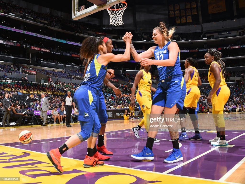 Cayla George #22 of the Dallas Wings celebrates during the game Los Angeles Sparks on July 12, 2018 at STAPLES Center in Los Angeles, California.