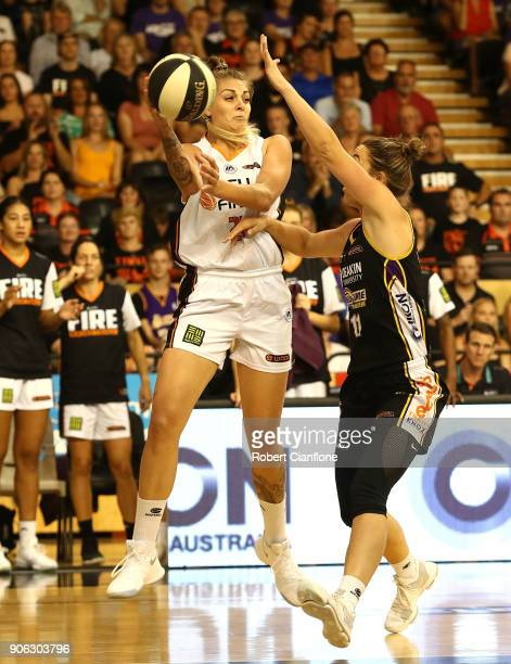 Cayla George of the Townsville Fire is challenged by Jenna O'Hea of the Melbourne Boomers during game two of the WNBL Grand Final series between the...
