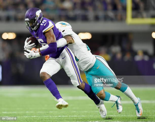 Cayleb Jones of the Minnesota Vikings avoids a tackle by Jordan Lucas of the Miami Dolphins during the third quarter in the preseason game on August...