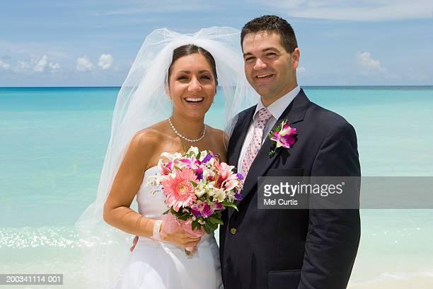 Cayman Islands, Grand Cayman, bride and groom on beach, portrait