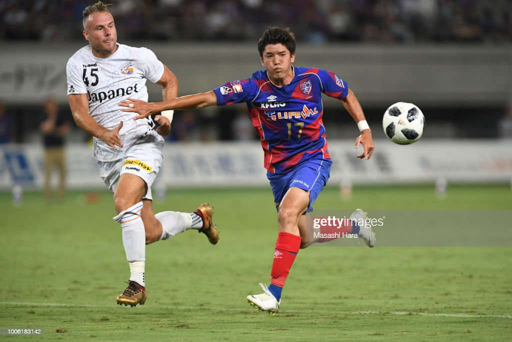 Cayman Togashi of FC Tokyo and Jordy Buijs of V-Varen Nagasaki compete for the ball during the J.League J1 match between FC Tokyo and V-Varen Nagasaki at Ajinomoto Stadium on July 27, 2018 in Chofu, Tokyo, Japan.