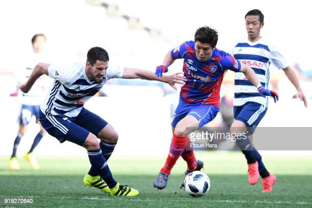 Cayman Togashi of FC Tokyo and Milos Degenek of Yokohama FMarinos compete for the ball during the preseason friendly match between FC Tokyo and...