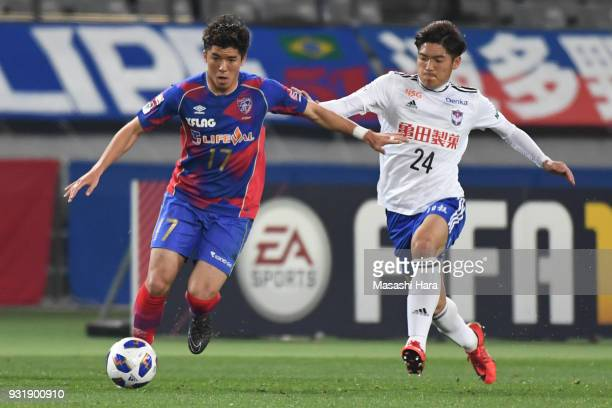 Cayman Togashi of FC Tokyo and Naoki Kawaguchi of Albirex Niigata compete for the ball during the JLeague YBC Levain Cup Group A match between FC...