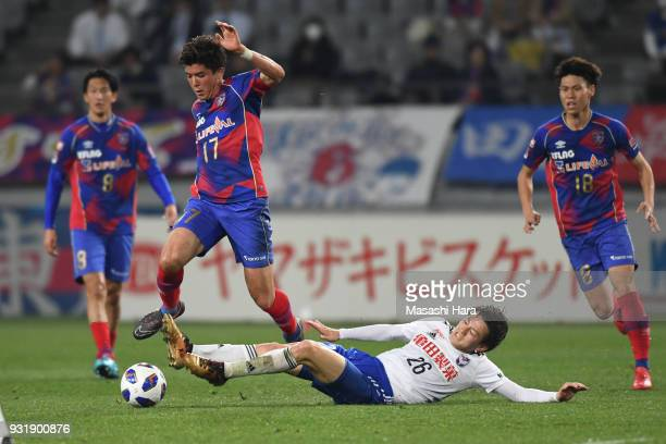 Cayman Togashi of FC Tokyo and Sachiro Toshima of Albirex Niigata compete for the ball during the JLeague YBC Levain Cup Group A match between FC...