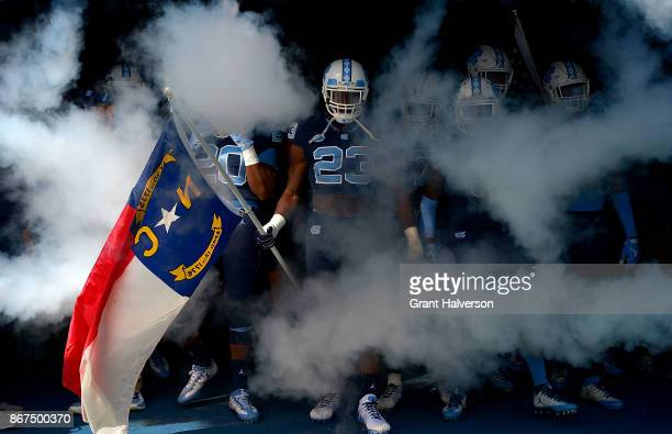 Cayson Collins of the North Carolina Tar Heels prepares to lead the team onto the field during their game against the Miami Hurricanes at Kenan...