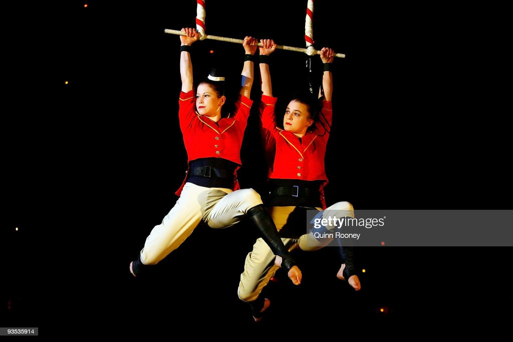 Caz Walsh and Hannah Cryle perform on the trapeze as graduates perform at the National Institute of Circus Arts on December 2, 2009 in Melbourne, Australia.