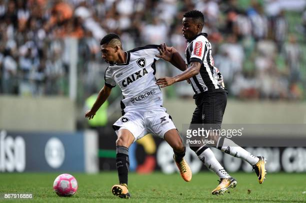 Cazares of Atletico MG struggles for the ball with Matheus Fernandes of Botafogo during a match between Atletico MG and Botafogo as part of...