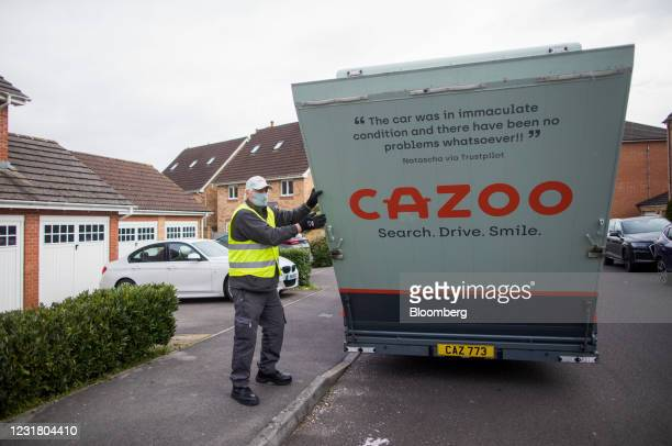 Cazoo Ltd. Employee prepares to unload an automobile from a transportation vehicle outside a residential property in Southampton, U.K., on Thursday,...