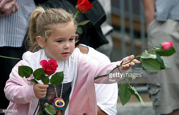 Cazzandra Peterson leaves flowers at Ground Zero in memory of father William Peterson during the 7th annual 9/11 memorial ceremony September 11 2008...