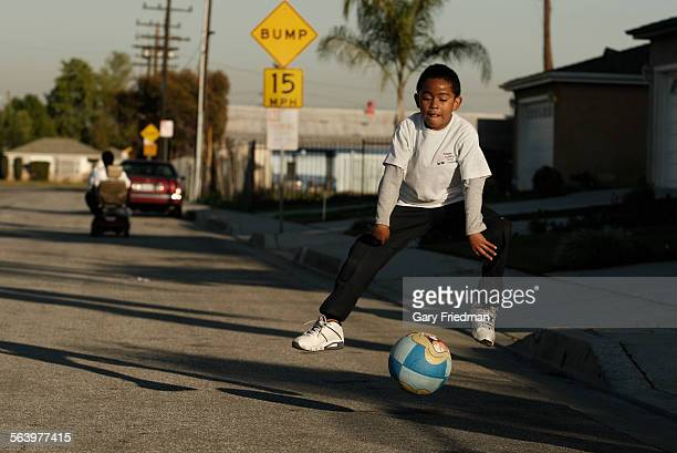 Cazzie Waller plays ball with his father Vincent Waller on 134th St in Compton on February 13 2013 Vincent purchased his 1600 square foot 4 bedroom 2...
