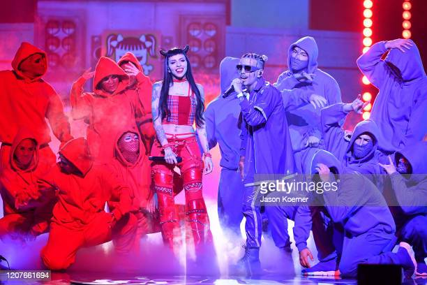 Cazzu and Rauw Alejandro perform live on stage during Univision's Premio Lo Nuestro 2020 at AmericanAirlines Arena on February 20 2020 in Miami...