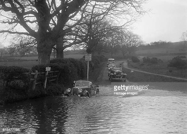 Cc Singer Le Mans driving through water during a motoring trial, 1936. Singer Le Mans 972 cc. Event Entry No: 7. Place: Unidentified Trial. Date:...