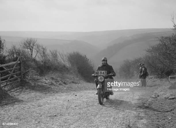 498 cc Triumph of CJ Dennis MCC Lands End Trial top of Beggars Roost Exmoor 1939 Artist Bill Brunell