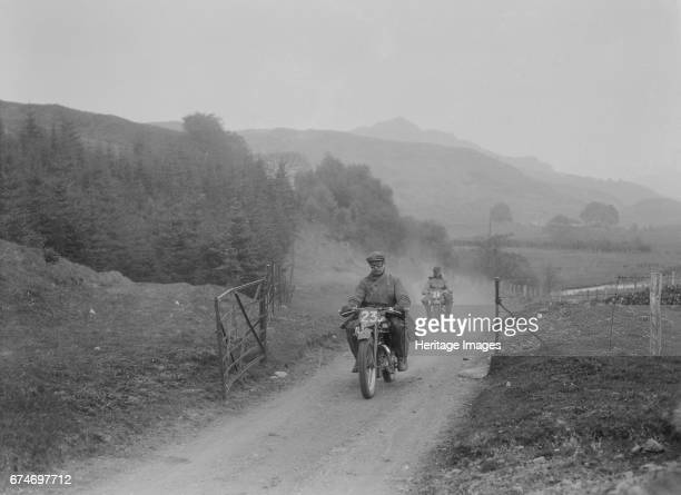 493 cc Triumphs of L Crisp and KP Jones competing in EDMC Scottish 6 Days Trial 1933 Artist Bill Brunell