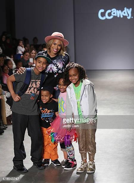 CCandy Clothing owner Amber Sabathia poses with her kids Carsten Charles Sabathia III Carter Sabathia Jaden Sabathia and Cyia Sabathia attend the...