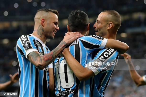 Cícero of Brazil's Gremio celebrates after scoring against Argentina's Atlético Tucuman during their Copa Libertadores 2018 football match held at...