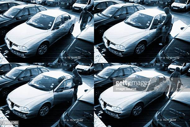 Cctv footage of a thief stealing from a car