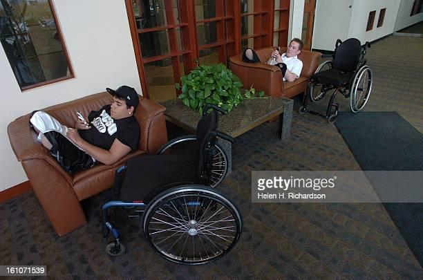 cd24CRASH_HHR April 23 2007 Berthoud High School wrestlers Tyler Carron far right <cq> and Nikko Landeros <cq> left rest comfortably in chairs inside...