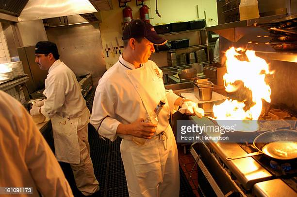 Arnold Rubio >cq> right flambes shrimp in the kitchen of Tamayo Restaurant at 1400 Larimer St Many restaurants are already completely booked during...