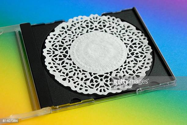 cd-case with a paper mat - doily ストックフォトと画像