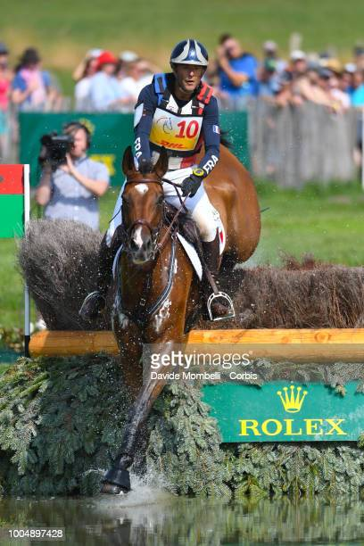 Cédric Lyard of France riding Unum de'Or during the obstacle in the water of the Cross Country test DHLPrize in the park of the CHIO of Aachen on...