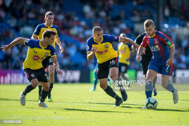 Cédric Soares and Oriol Romeu of Southampton and Max Meyer of Crystal Palace during the Premier League match between Crystal Palace and Southampton...