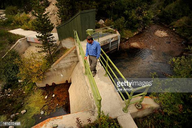 CDXXWATER17f Kikr Klancke a Winter Park water official standard on a Denver Water diversion dam that channels Jim Creek into a collector that will...
