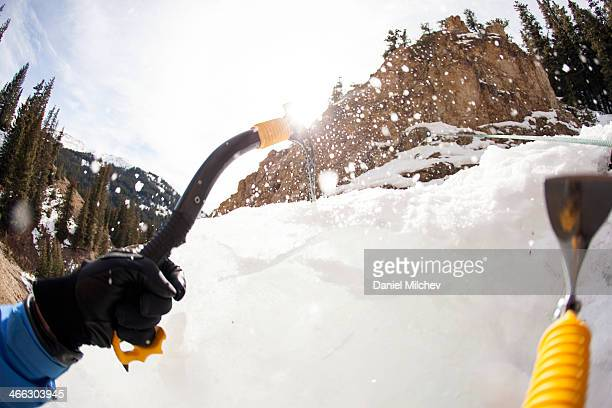 ce climber on a frozen waterfall.