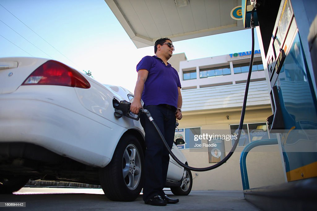 Ceasar Fernandez uses a gas station's pumps to fill his vehicle with gas on February 4, 2013 in Miami, Florida. Reports indicate that gas pump prices are at their highest level on record for this period of the year and may be an indication that the year ahead may see even higher records.