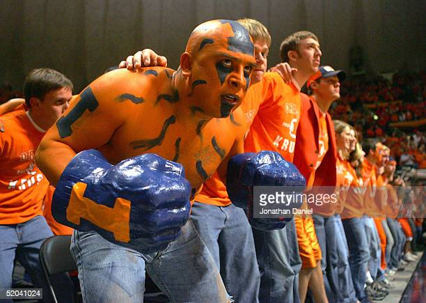 Ceasar Perez, a fan of the Illinois Fighting Illini, joins other students as they sway during player introductions before a game against the Iowa...
