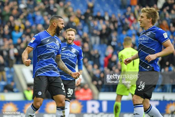 Cebio Soukou Marcel Hartel and Joan Simun Edmundsson of Bielefeld celebrate their teams first goal during the Second Bundesliga match between DSC...