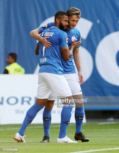 Cebio Soukou of Rostock celebrates with team mate Kai Buelow after scoring the first goal during the 3Liga match between FC Hansa Rostock and...