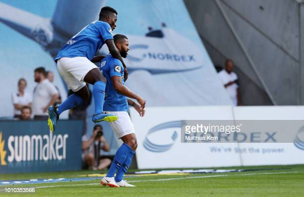 Cebio Soukou of Rostock celebrates with team mate Merveille Biankadi after scoring the first goal during the 3Liga match between FC Hansa Rostock and...
