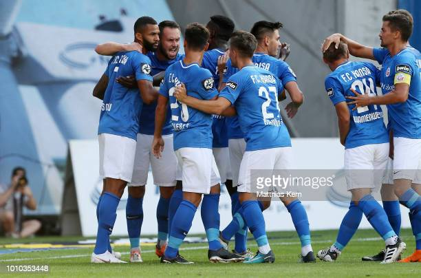 Cebio Soukou of Rostock celebrates with team mates after scoring the first goal during the 3Liga match between FC Hansa Rostock and Eintracht...