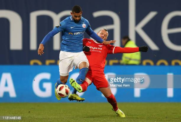 Cebio Soukou of Rostock challenges for the ball with Toni Lindenhahn of Halle during the 3. Liga match between F.C. Hansa Rostock and Hallescher FC...