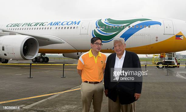 Cebu Pacific President and Chief Executive Officer Lance Gokongwei and his father John Gokongwei Jr stand in front of a new Airbus A330-300 from...