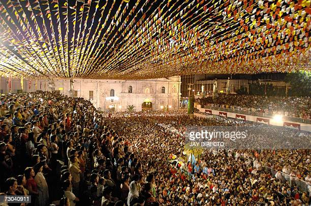 Devotees attend a mass at the Basilica Del Santo Nino in Cebu city 19 January 2007 The mass is part of a nineday religious festival but the main...