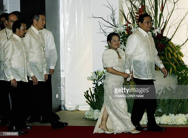Hostess Philippine President Philippine President Gloria Macapagal Arroyo and her husband Jose Miguel Arroyo followed by Singaporean Prime Minister...