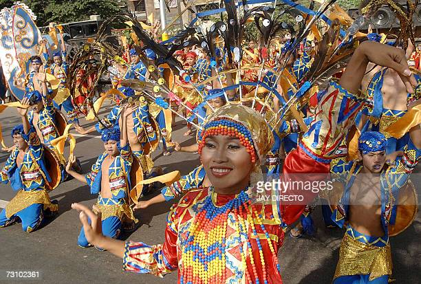 Performers dancing in the street during the culmination of the nineday religious festival called Sinulog in Cebu city 21 January 2007 Sinulog is a...