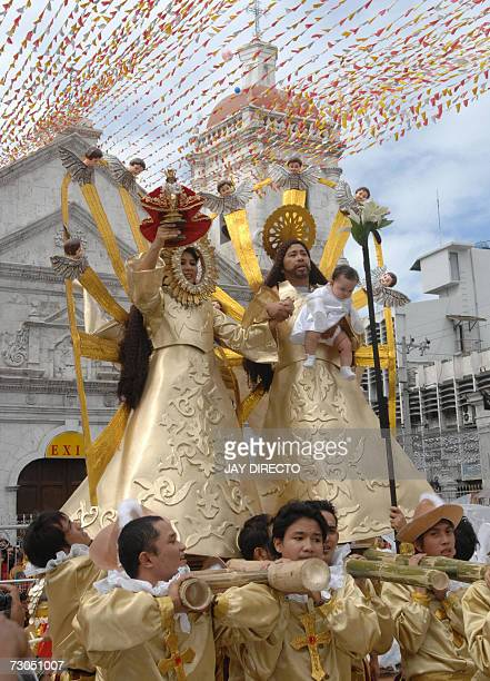 Performers symbolizing the Virgin Mary and Joseph carrying Jesus as an infant parade after a mass at the Basilica Del Santo Nino in Cebu city 20...