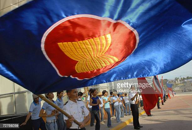 Students carrying ASEAN flags practice outside the Cebu International Convention Center 07 December 2006 The central Philippine city of Cebu is...