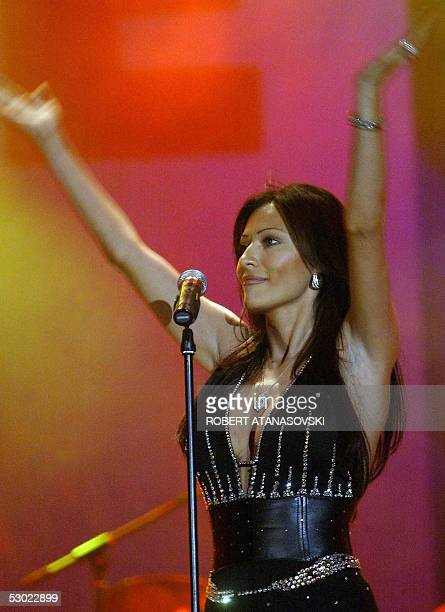 Ceca Raznatovic performs at a concert for over 30 000 fans in Skopje 04 June 2005 Raznatovic not only a wellknown folk singer but also widow of the...