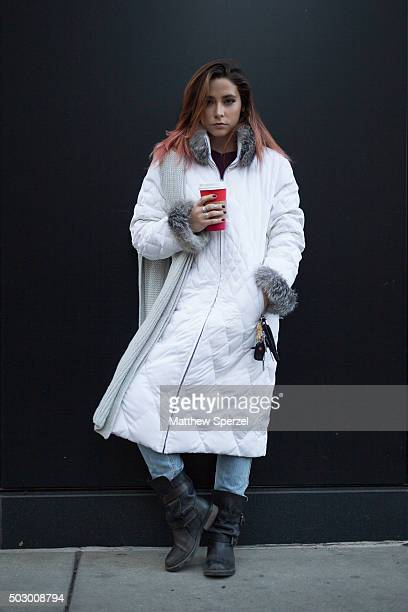 CeCe Frey is seen on Michigan Avenue wearing a white Marvin Richards coat blue denim Levis jeans and black Steve Madden boots on December 19 2015 in...