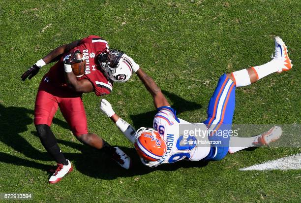 Cece Jefferson of the Florida Gators is called for a facemask penalty as he tackles Mon Denson of the South Carolina Gamecocks during their game at...