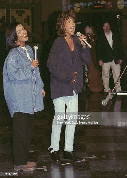 """CeCe Winans sings along with Whitney Houston at Webster Hall, where Houston is filming her music video, """"Count on Me,"""" from the movie """"Waiting to..."""