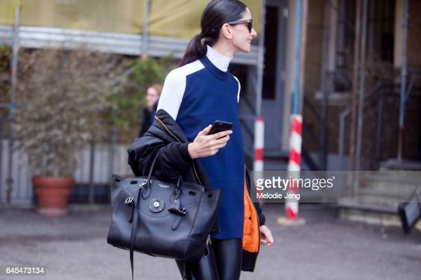 Ceci Mendez wears a jacket off her shoulders and a black Ralph Lauren bag outside Missoni during Milan Fashion Week Fall/Winter 2017/18 on February...