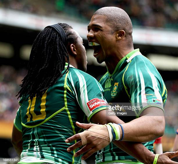 Cecil Afrika of South Africa celebrates with Cornal Hendricks of South Africa after scoring a try during the match against USA during the Marriottt...