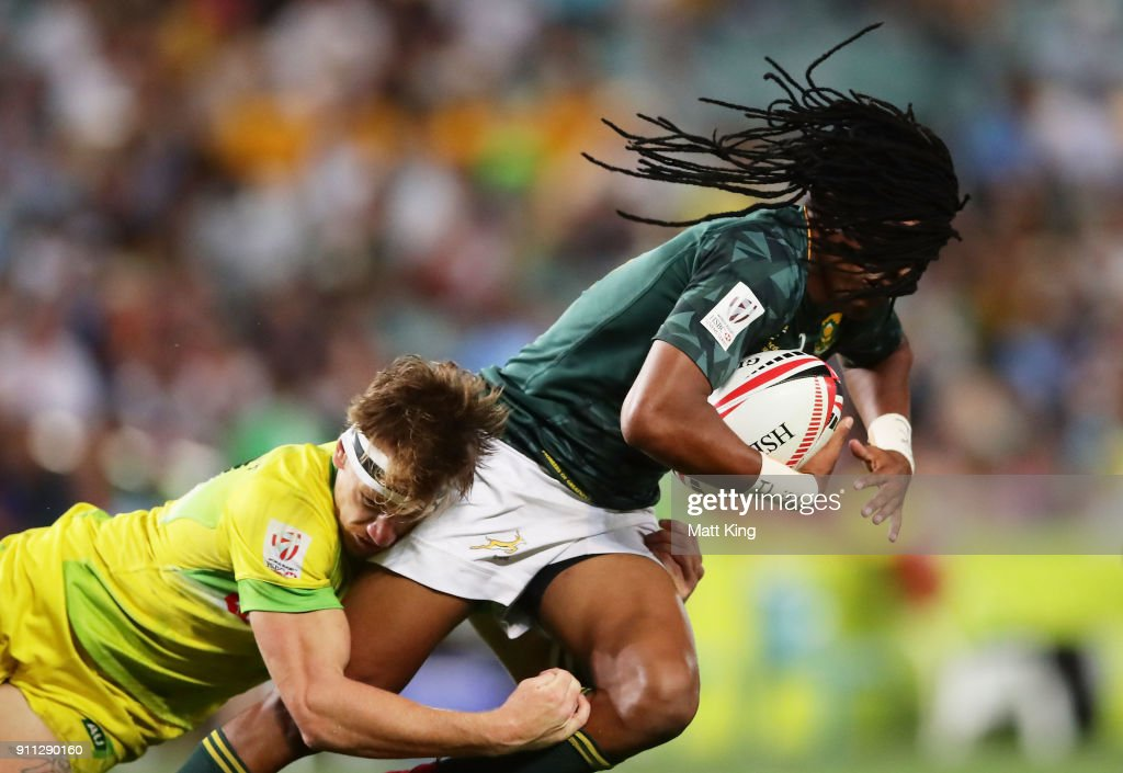 Cecil Afrika of South Africa is tackled by Ben O'Donnell of Australia in the Men's final match during day three of the 2018 Sydney Sevens at Allianz Stadium on January 28, 2018 in Sydney, Australia.